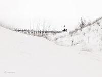 snow,drifts,winter,lake,michigan,lighthouse