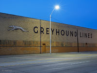old,school,greyhound,facility,night,motor,city