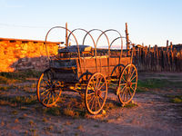 sun,setting,on,old,buggy,wagon,hubbell,trading,post