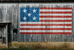 Barn Flag & Wood Pile