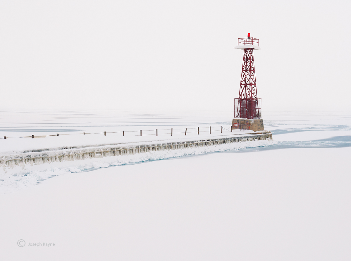 A Frozen Light Beacon On Lake Michigan During A Polar Vortex