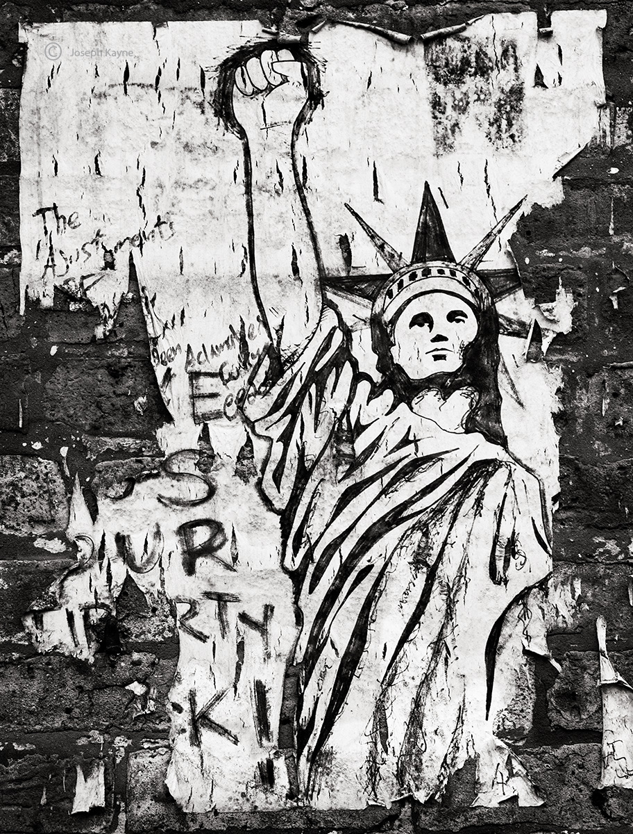 fight,the,power,decaying,street,art,give,us,our'liberty,back, photo