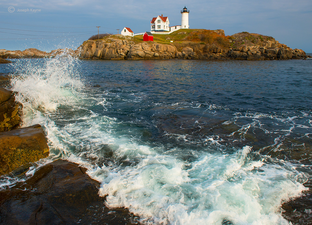 maine,coast,wave,crashes,by,nubble,lighthouse, photo