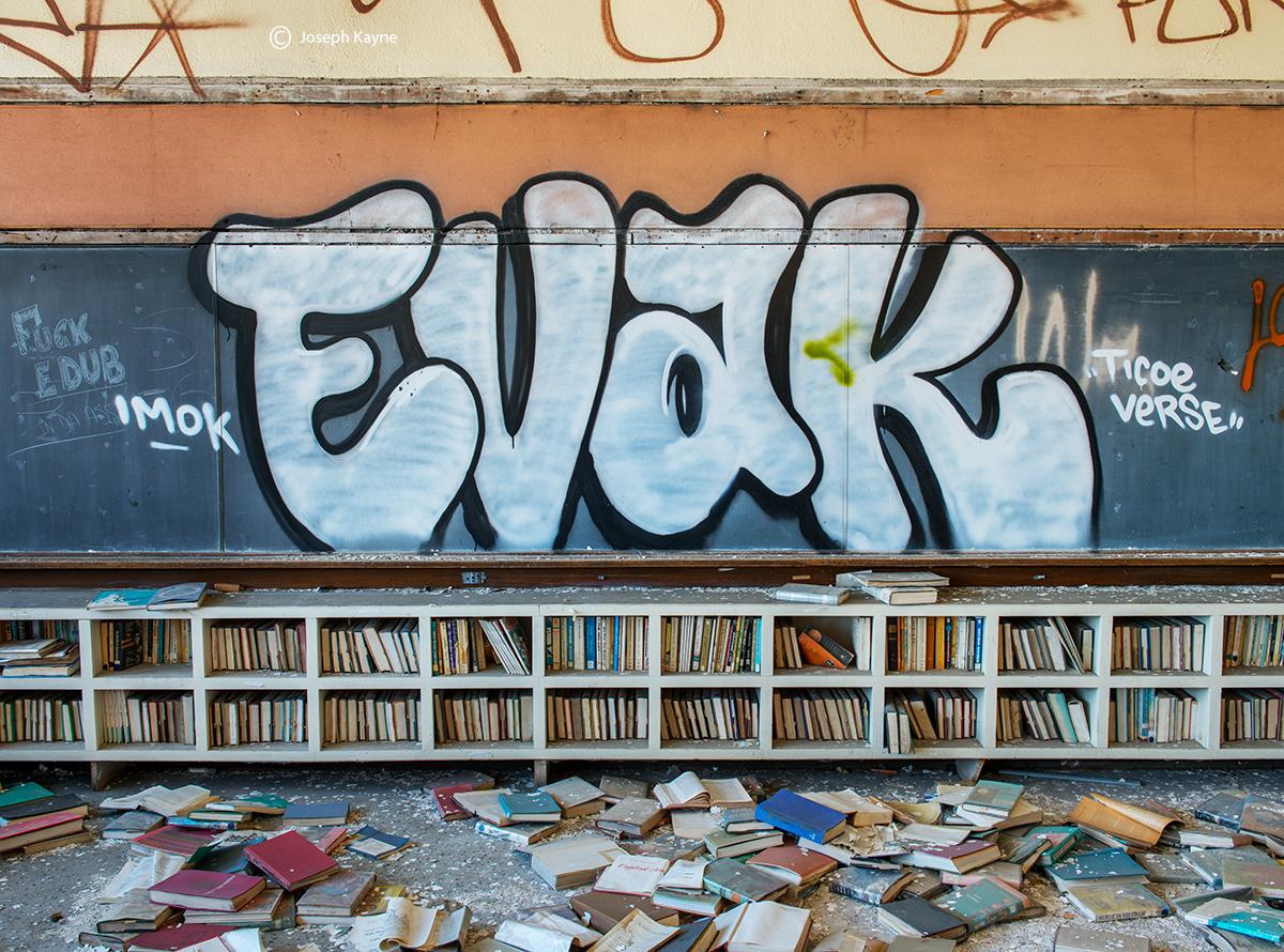 Fallen Books In An Abandoned School