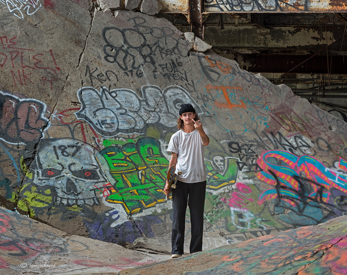 portrait,of,skateboarder,abandoned,detroit,factory, photo