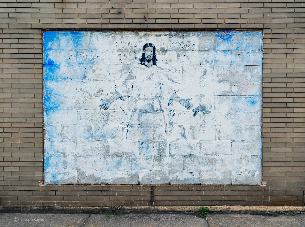 faded,jesus,religious,mural,abandoned,church,rust,belt, photo