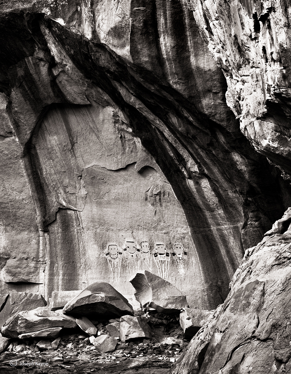 Ancient Pictographs Stand Sentinel Over A Sandstone Canyon