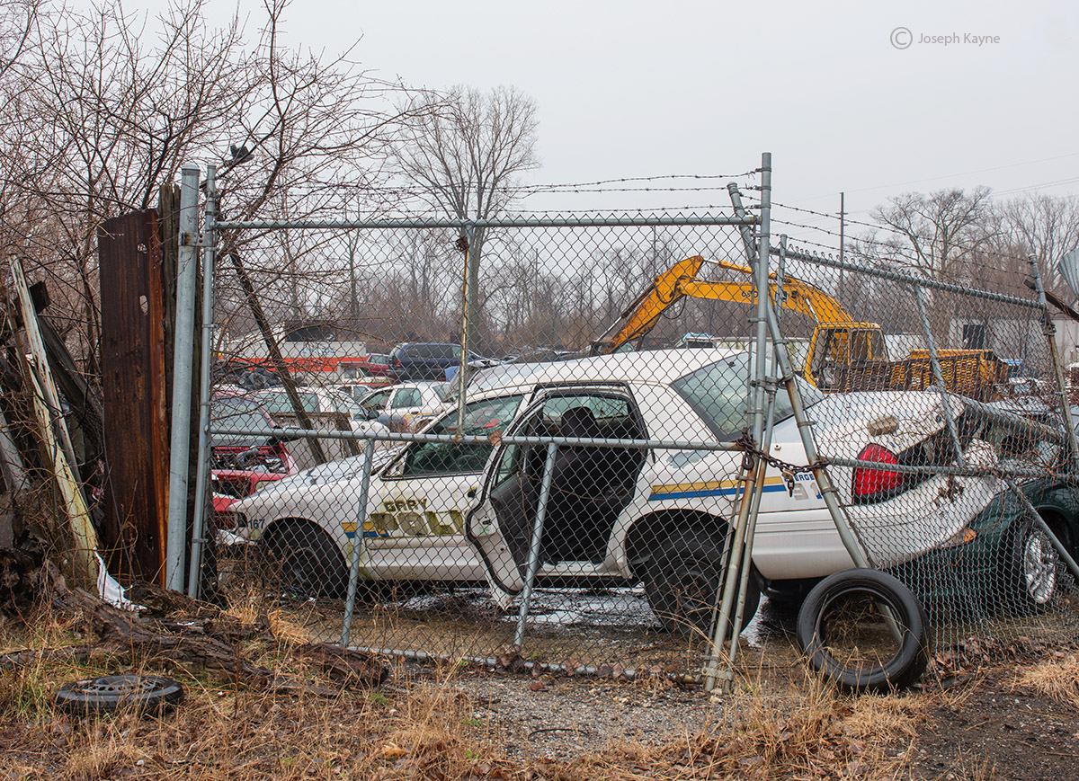 gary,finest,abandoned,police,car,junked, photo