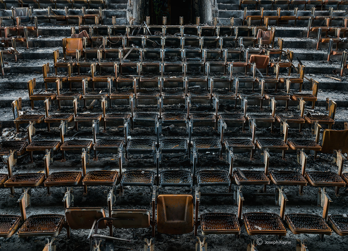 burnt,abandoned,high,school,auditorium,seats,rust,belt, photo