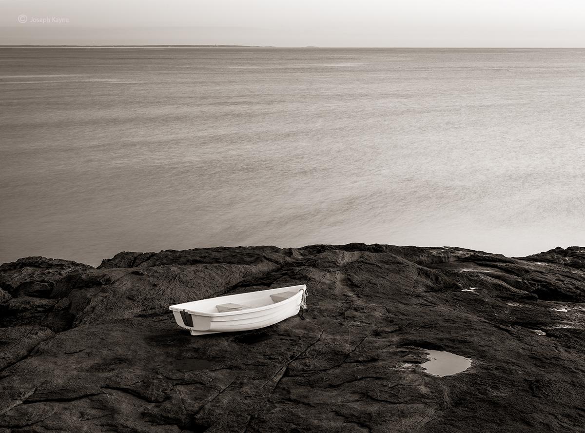 Row Boat On The Rocks