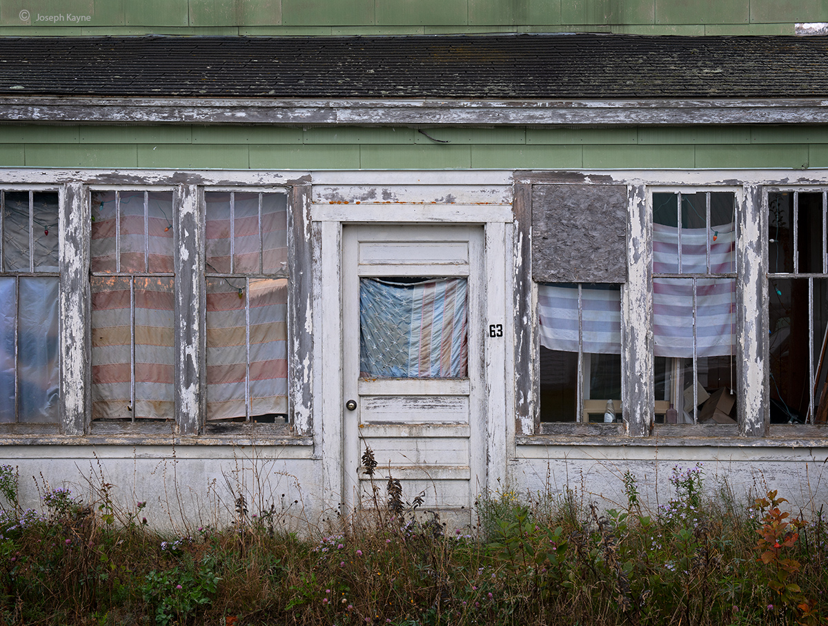 Old House & Faded Flags